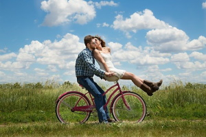 romantic couple on bike at therapy